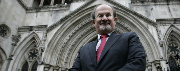 Award-winning author, Sir Salman Rushdie poses for the photographers in front of central London's High Court, Tuesday Aug. 26, where a Declaration of Falsity was to be made against the author and publisher of a book in which defamatory statements were made against Rushdie. Author and convicted fraudster, Ron Evans along with publisher John Blake have admitted there were falsehoods in the text of 'On Her Majestys Service'. Evans, Blake and ghostwriter Douglas Thompson have agreed to apologise in open court on eleven counts of lying. (AP Photo/Lefteris Pitarakis)